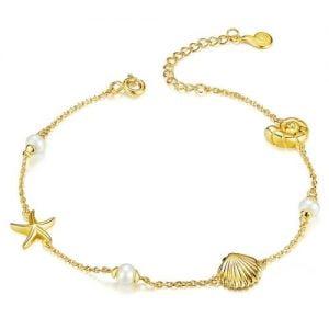 Bracelet avec perles et coquillages pour femme